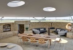Duncan Jackson designed the cherry wood dining table and Martello sofas inside the Martello tower. Home And Living, Home And Family, Loft Style Homes, Mad About The House, Unusual Buildings, Beautiful Buildings, New York Loft, Dome House, Outdoor Furniture Sets