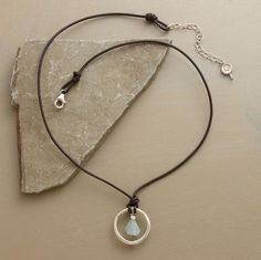 metal circle, stone pendant, leather cord necklace
