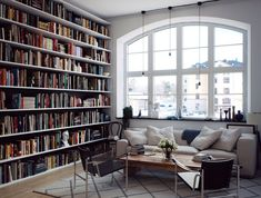 Wall-to-Wall, floor to ceiling bookshelves.