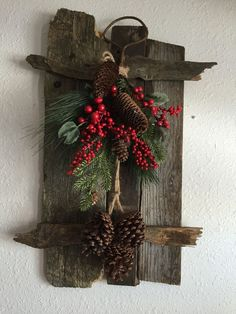 Re-Scape Fan Tamara Kardoskee made the back boards with pieces of wood from around the farm and put an arrangement of greens on it! Pinterest Christmas Crafts, Christmas Wood Crafts, Christmas Door Decorations, Christmas Centerpieces, Rustic Christmas, Christmas Art, Christmas Projects, Holiday Crafts, Christmas Wreaths