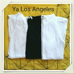3 pk Long Sleeve Tees by Ya Los Angeles Three fabulous long sleeve tees by Ya Los Angeles. Super soft and fabulous for layering. Lightweight knit that is slightly sheer, so same color bra is suggested. 75% algodon, 25% rayon. One white crew neck, one black crew neck, one white V-neck. All size large. Body hugging fit, so could fit medium as well. All in good pre-loved condition. No stains or tears. White crew neck has most pilling. Not significant, but the most of the three (pictured)…