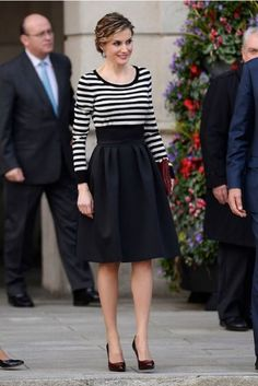 Spanish Queen Letizia in a black and white striped top.  She teamed her top with a high-waisted full black skirt, patent plum court shoes and a plum clutch with leather flower decoration from Uterque.