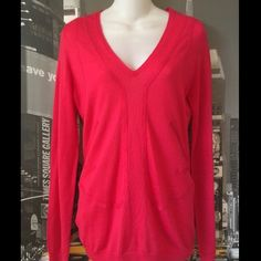 BCBG hot pink sweater BCBG hot pink architectural Sweater. Very light weight. Perfect for the Spring season! Wool blend , silky soft on. 4 moth holes as shown. I believe they can be stitched closed and not very noticeable since 3 of them are in the back the other is on the sleeve. BCBG Sweaters V-Necks