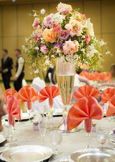 Peach and Coral Rose Centerpieces Floral by Branson Party Rentals Featured on the Knot!