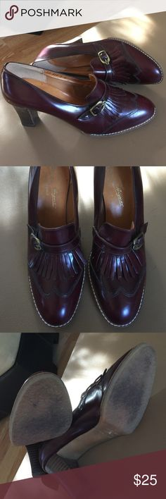 Real Italian leather. Leather uppers and a rubber sole for comfort. They've never been worn, only tried on. Bought for office wear, however never made use of. Pretty burgundy with brass buckle and tassels. Lots of details. Etienne Aigner Shoes Heels