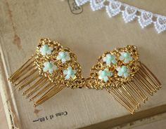"""Two wonderful - bridal hair comb Victorian shabby chic vintage style with real Turquoise Set of two - you get 2 . Victorian style gold plated hair comb with real vintage Turquoise beads. The beads are real vintage Turquoise beads from 50's necklace that I took apart . Perfect for brides good luck , something old something new ans something blue ... measures 2 """" wide, 2 high . You get 2"""