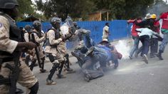 Hundreds of Haitians take part in a march demanding the resignation of President Martelly two days after Prime Minister Lamothe stepped down.