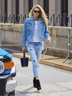 It's in her jeans! Australian beauty Jessica Hart cuts a casual figure as she steps out in New York in a statement double denim look | Daily Mail Online