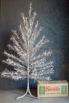 Get into the retro holiday spirit with a vintage aluminum Christmas tree. We have several for my room this year? Christmas Past, Little Christmas, All Things Christmas, Christmas Holidays, Christmas Decorations, Christmas Mantles, Christmas Photos, White Christmas, Christmas Cards