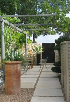 Concrete pavers and gravel. Steel and wire pergola will last forever with vines. Note the lighting mounted to pergola. Modern Pergola, Outdoor Pergola, Backyard Pergola, Backyard Landscaping, Pergola Kits, Metal Pergola, Metal Roof, Patio Fence, Raised Patio