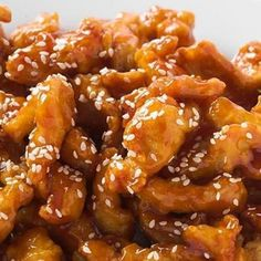 Crockpot Sesame Chicken - 1 1/2 pound boneless/skinless chicken breasts 1/2 cup honey 1/4 cup soy sauce 2 tablespoons dried onion 2 tablespoons ketchup 1 tablespoon oil 1/2 teaspoon garlic powder 2 teaspoons cornstarch dissolved in 3 Tablespoons water Sesame seeds