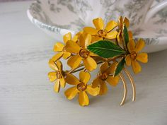 Vintage Sunny Yellow Painted Metal Flower Pin. $12.00, via Etsy.
