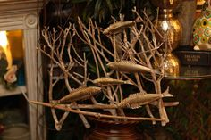 brown metal twig with fish art display  Evergreen at the Lake of the Ozarks  home decor store