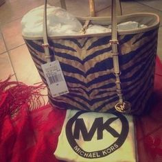 I just discovered this while shopping on Poshmark: NWT Michael Kors zebra tote with MK behind it!. Check it out!  Size: Medium