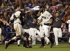 San Francisco Giants relief pitcher Sergio Romo and catcher Buster Posey react after the final out in Game 7 of baseball's National League championship series against the St. Louis Cardinals Monday, Oct. 22, 2012, in San Francisco. The Giants won 9-0 to win the series.