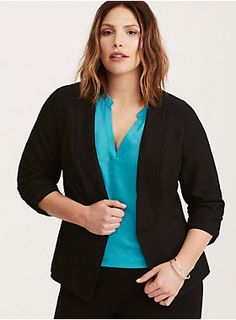 """Smash that snooze button; this is the work blazer that works with every outfit. The black crepe is surprisingly lightweight - perfect for a summer uniform. The draped front, faux pockets, and ruched sleeves will make it the first thing you reach for in the morning.      Model is 5'9.5"""", size 1     Size 1 measures 32"""" from shoulder  Polyester/rayon/spandex  Wash cold, dry low  Imported plus size blazer"""