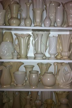 Nice collection of pottery. I love semi matte white glazes. Mccoy Pottery Vases, Roseville Pottery, Pottery Art, Vintage Vases, Vintage Pottery, Vintage Love, Constance Spry, Shawnee, Displaying Collections