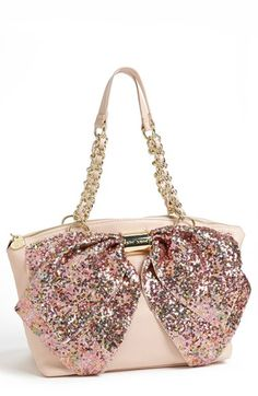 Betsey Johnson 'Bow-Nanza' Satchel An oversized bow drapes the front of a playful satchel rendered in pebbled faux leather. Gilt hardware lends luscious luster to the style.