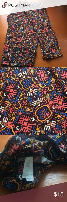 TC Leggings Cool print leggings! Background color is black with blue, coral, cream and orange.  New without tag. LuLaRoe Pants Leggings
