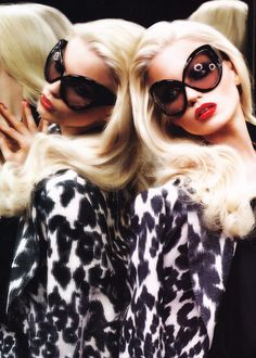 Tom Ford-the best combo!  Platinum hair, red kiss, over the top Sophia Loren sunglasses and a nod to animal print