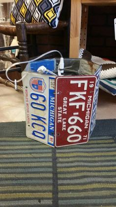Upcycled license plate lamp https://www.etsy.com/listing/240110241/upcycled-vintage-license-plate-hanging