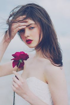 Deep red lips & light rosy cheeks - via Weddingish.