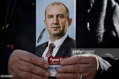 04-02 A supporter of Bulgarian Socialist party holds a picture... #rogaskaslatina: 04-02 A supporter of Bulgarian… #rogaskaslatina