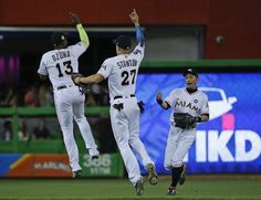 New sultan of swat: Stanton's year won't be forgotten  -  October 2, 2017:    Miami Marlins' Marcell Ozuna (13) Giancarlo Stanton (27) and Ichiro Suzuki, right, of Japan, celebrate after they defeated the Atlanta Braves in a baseball game, Friday, Sept. 29, 2017, in Miami. (AP Photo/Wilfredo Lee)