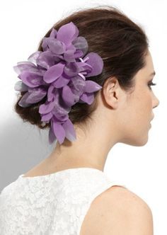 I love updos with elegant flowers pinned in..