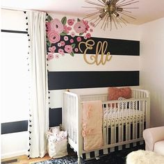 LOVE this Kate Spade-inspired nursery. We love how these floral decals were used on top of the black and white stripe wall for a seriously chic design.  Image by @papar0xxie