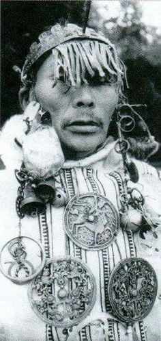 B/W phototo of Siberian (Nganasan people) shaman with a similar pendants,museum collection,Russia.