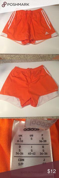 Adidas Soccer Shorts Orange Adidas soccer shorts! Fit great, just don't play soccer anymore. Adidas Shorts