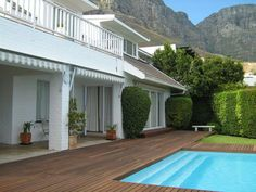 Atholl Villa - Atholl Villa is situated in the upmarket area of Camps Bay.  This luxury four-bedroom house with a beautiful garden and clear swimming pool boasts stunning sea views.  The epitome of modern, upmarket luxury ... #weekendgetaways #campsbay #southafrica