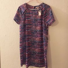 Multicolored Tunic Dress Sassy but conservative dress. Flattering on all body types. Never worn NWT Forever 21 Dresses