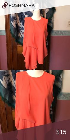 Beautiful orange summer top Gorgeous summer top . Looks great with a jacket for the office or pair it with some cute jeans for the club never worn . With out tags Tops Blouses