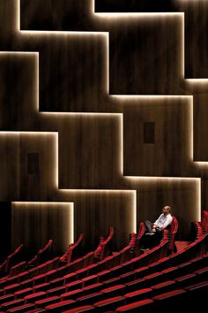 diffused light running beneath concrete clad walls, creates nice rhythm to the space as it aims towards the stage