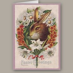 """Vintage Easter Card  It's the Easter Bunny! Surrounded by a circle of flowers on a pink background. A delightful Easter Card for a lady. The simple caption reads, """"Easter Greetings"""". The inside of this card has been left blank waiting for your speical Easter message."""