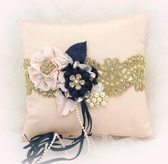 Wedding Ring Pillow Navy Blue Blush Pink Gold, Vintage Style Ring Bearer Pillow Ring Cushion Size: 8 inches square This ring holder pillow is absolutely decadent! Crafted in shades of blush pink, navy blue and gold, this wedding ring pillow is just a magnificent accessory for your wedding.