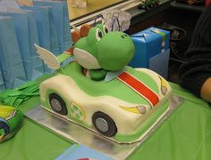 yoshi cake - the white of the car is bc, everything else is fondant or gumpaste. Yoshi's head, the body (that you really can't see), and the wheels are made of rc