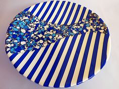 Spectrum Vanilla reactive glass with dark blue opaque glass and frit. 30cm fused and slumped.