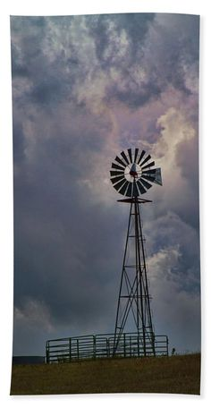This old windmill is used to pump water into a trough for livestock, usually cattle in this case. The sun was setting and the last rays added a hint of color to the dramatic clouds in the evening sky. This was captured in rural El Paso County in Colorado. Farm Windmill, Windmill Decor, Blowin' In The Wind, Old Windmills, Large Beach Towels, Image Gifts, Paint And Sip, Evening Sky, Old Barns