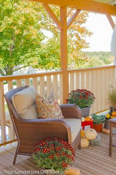 Autumn decorating on our porch with mums, gourds & pumpkins