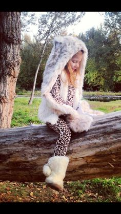 Girls snow leopard costume. Snow leopard spirit hood, baby gap fur boots, snow leopard print pants and sweater. Snow leopards are her favorite.