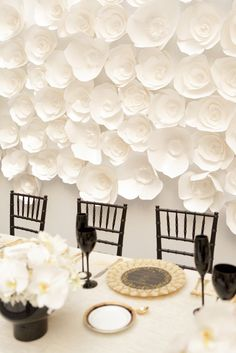 A white paper flower backdrop makes a big impact at this chic and modern black and white wedding in detroit.  Detroit Waterfront Wedding from Alli McWhinney Photography  Read more - http://www.stylemepretty.com/2013/06/24/detroit-waterfront-wedding-from-alli-mcwhinney-photography/