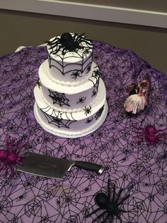 Wedding at The Fez- 3 tiered round cake with spider webs/spiders. Zombie couple cake topper on the side. Happy Halloween! ☠