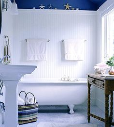 Love that dark blue with the height of the white beaded board. It doesn't let the bold color take over the small bath space.