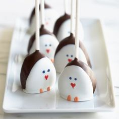 TOO CUTE! Penguin pops...dip strawberries first in chocolate, let harden, then lay the front in white chocolate, let harden and then use edible markers to draw on face.