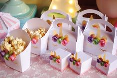 Loving the popcorn and party favor boxes at this Unicorn Birthday Party!! See more party ideas and share yours at CatchMyParty.com #catchmyparty #partyideas #unicornbirthdayparty #girlbirthdayparty #unicornpartyfavor #unicornpopcorn