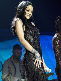 Star Tracks: Monday, March 28, 2016 | STUNNER STYLE | On Sunday, a gorgeous Rihanna takes the stage in a sheer black dress at her Anti World Tour stop in Brooklyn, New York.