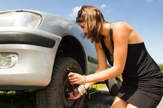 Changing a tyre. Young woman changing a flat tire on her car , Self Design, Flat Tire, Chuck Norris, Independent Women, Adventure Travel, Change, Stock Photos, Life Hacks, Writing